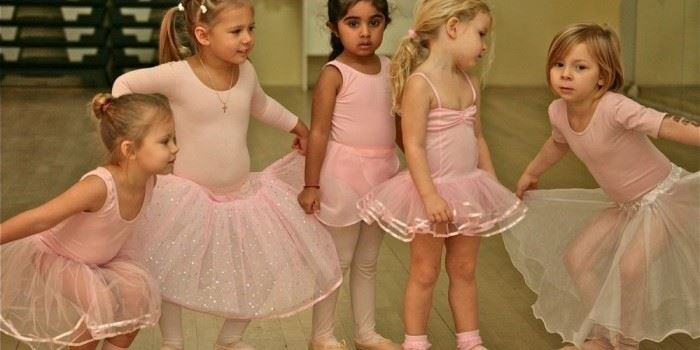 Young girls in ballet clothes.