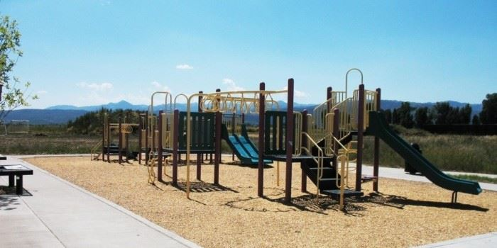 A large play area with mountains in the background.