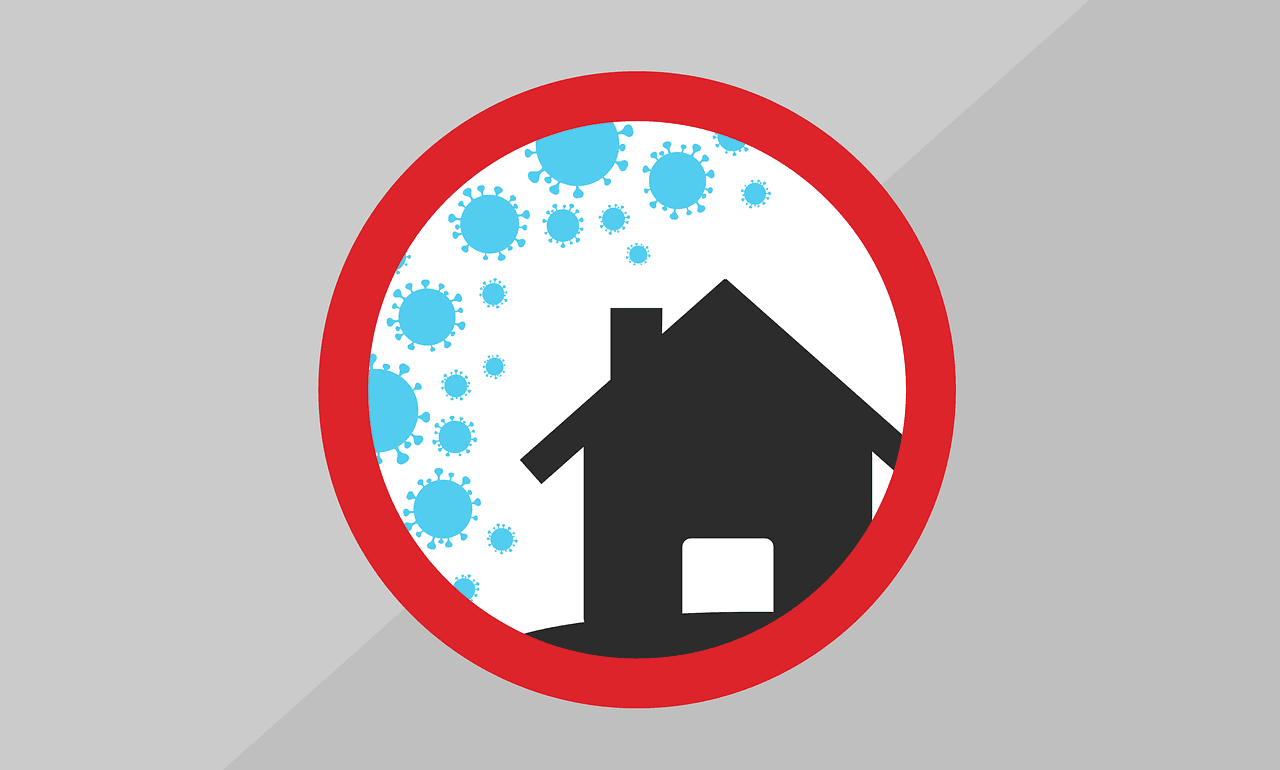 A graphic of a home surrounded by covid virus graphics